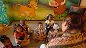 Little ones listen to a Cast Member tell a story at the Children's Activity Center 'Simba's Cubhouse'