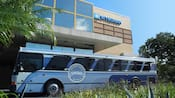 A building with a sign that reads Wyndham near a bus with a sign that reads Disney Springs Resort Area Hotels