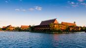 View from the lake at Disney's Polynesian Resort beneath blue skies