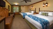 Rustic, bayou-themed bedroom with 2 beds, log furniture headboards, curtained window,