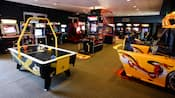 Air hockey, basketball and racing car games in an arcade at Disney's Saratoga Springs Resort & Spa