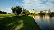 The grassy shoreline and grounds surrounding Disney's Saratoga Springs Resort & Spa
