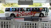 A complimentary Disney bus waiting at a stop at Disney's Grand Floridian Resort & Spa