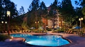The Hidden Springs Pool at Disney's Wilderness Lodge, lit up at night