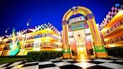 Exterior of Disney's All Star Music Resort illuminated at night