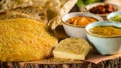 Assorted breads served with a trio of dipping sauces