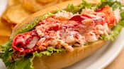 A lobster roll with a side of chips