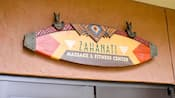 A sign above a set of doors reads: Zahanati Massage & Fitness Center