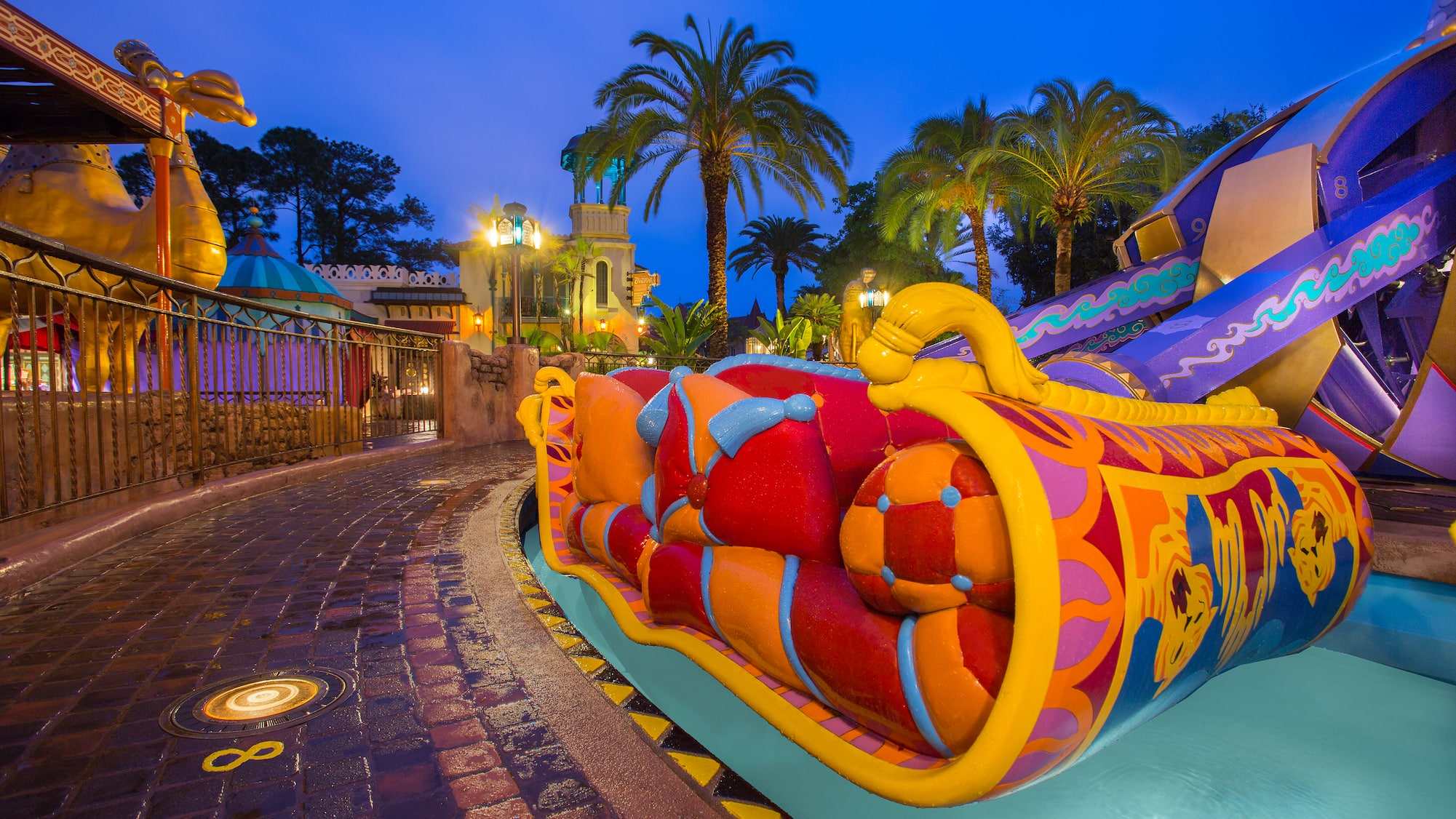A Section Of The Magic Carpets Aladdin Attraction Next To Huge Camel Statue At