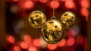 An ornament in the shape of a Mickey icon