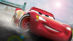 Lightning McQueen speeds down the racetrack at Disneys Hollywood Studios