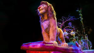 A float depicting Simba, a tree and African folk art