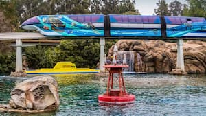 The Argonaut, one of the Finding Nemo Submarine Voyage vehicles, floats on the water under the monorail