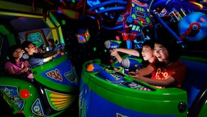 Kids shoot lasers at Zurg's evil robots on Buzz Lightyear Astro Blasters