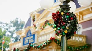 A lamp post on Main Street, USA decorated with a wreath