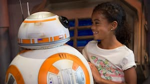 A young female Guest meets BB-8 inside 'Star Wars' Launch Bay at Disney's Hollywood Studios