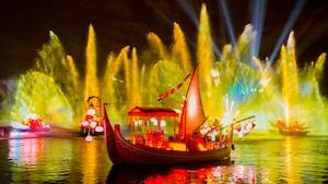 Projeções e efeitos especiais aquáticos iluminam a noite durante a Rivers of Light no Disney's Animal Kingdom Park