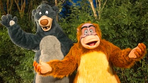 Baloo and King Louie await Guests at a Character Greeting experience at Disney's Animal Kingdom park