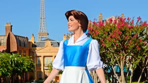 Belle smiling while she awaits Guests during a Character Greeting experience at the France Pavilion