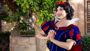 Snow White smiles while awaiting Guests at a Character Greeting experience at the Germany Pavilion