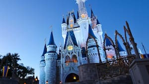 Cinderella Castle illuminates at night and stands tall as the iconic centerpiece of Magic Kingdom park