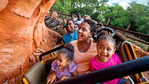 Guests scream in excitement while riding aboard a runaway locomotive on Big Thunder Mountain Railroad