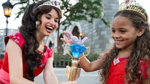 Disney princess entertainment attractions walt disney world resort princess elena laughs as a girl dressed in a princess elena costume touches her crystal scepter m4hsunfo