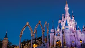 Cinderella Castle towers in the night sky at Magic Kingdom park during the Disney After Hours event