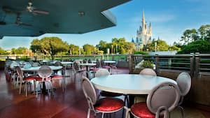 A seating area with a view of Cinderella Castle