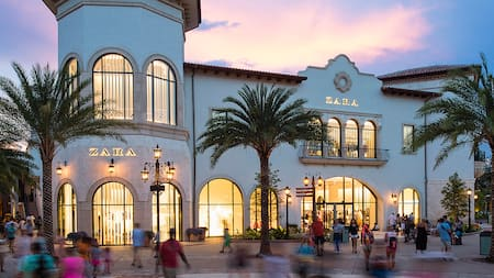People standing outside of the ZARA store at Disney Springs