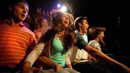 A group of seated people scream together