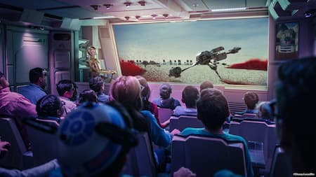 People in a theater watch a Star Wars film