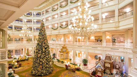 a christmas tree in a hotel lobby - When Is Disney Decorated For Christmas