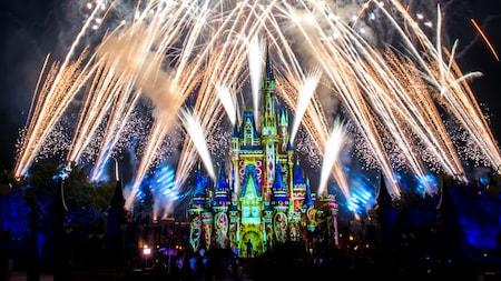 Streams of fireworks culminate in glowing orbs around Cinderella Castle