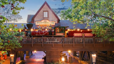 The Frontierland train station in Magic Kingdom Park at night