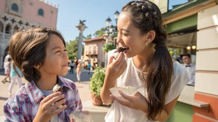 A little boy and girl enjoy confections together