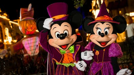 Mickey and Minnie dressed in Halloween ensembles