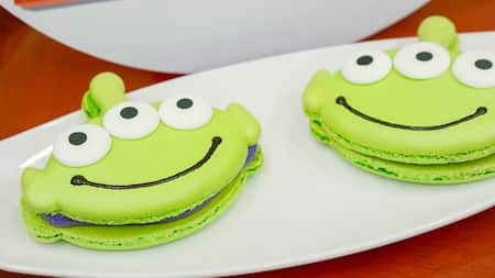 2 macarons shaped like the Aliens from Toy Story