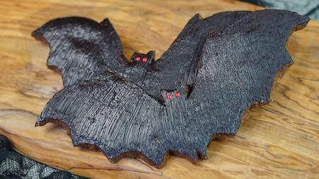 Two cookies shaped like bats