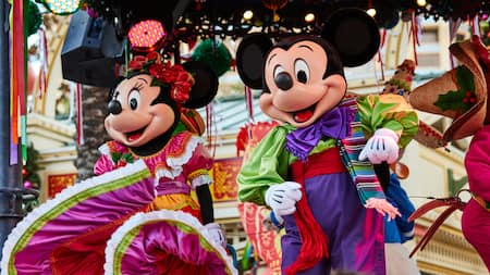 minnie mouse and mickey mouse dance on a stage - Mickeys Christmas Party Disneyland