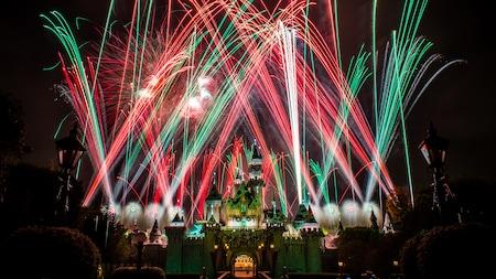 Fireworks burst in the sky above Sleeping Beauty Castle