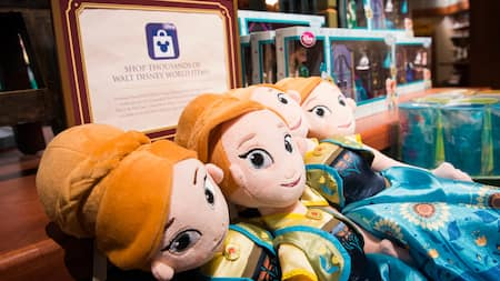 A store display featuring plush dolls of Anna as a young girl