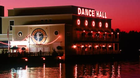 Atlantic Dance Hall after dark with a lit-up neon 'Dance Hall' sign