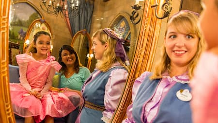 Disney princess entertainment attractions walt disney world resort a girl in a princess costume admires herself in a mirror with her mother and m4hsunfo