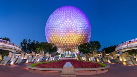 Spaceship Earth near 2 monorail trains