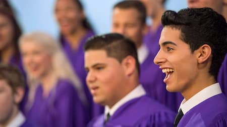 A boy sings in a choir