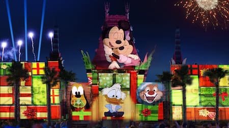 A light show featuring images of Mickey and Minnie Mouse, Goofy, Donald Duck and Dale projected on to the exterior of the Chinese Theater at Disney's Hollywood Studios