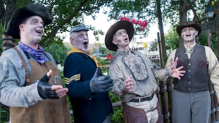 The undead barbershop quartet known as the Cadaver Dans performing for Guests at Magic Kingdom park