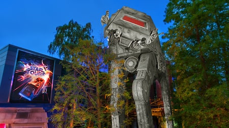 Signage for Star Tours – The Adventures Continue near an AT-AT Walker at Disney's Hollywood Studios
