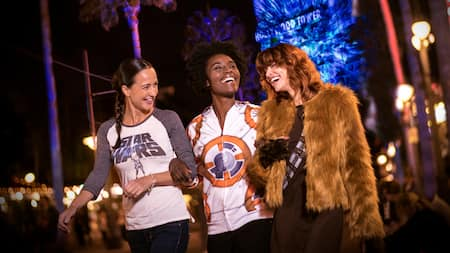 3 friends dressed in Star Wars attire walk around Walt Disney World Resort